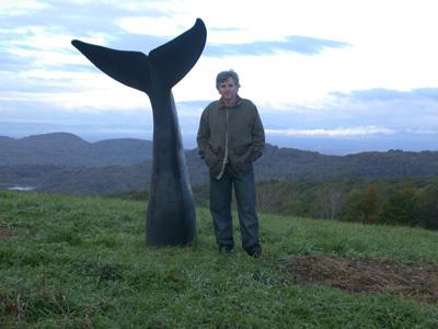 Jim Sardonis stands next to his Atkinson Memorial sculpture