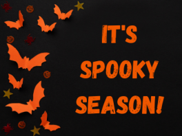 """Black and orange image with bats saying """"it's spooky season!"""""""