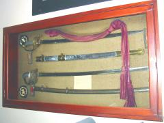 Two swords and holders