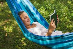 Girl in hammock reading