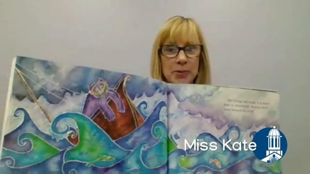 Miss Kate holding open a picture book
